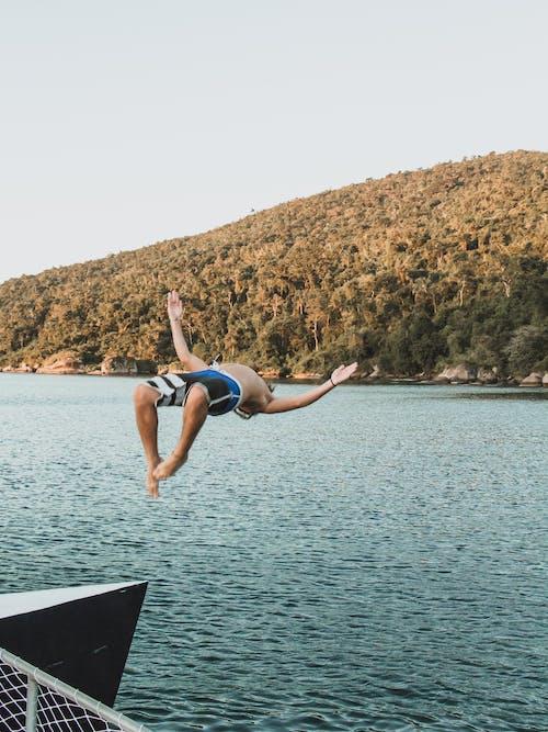 Photo of Man Diving on Lake