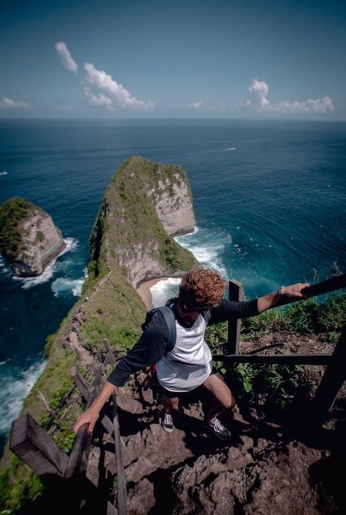 Person Climbing Up Rock Stairs
