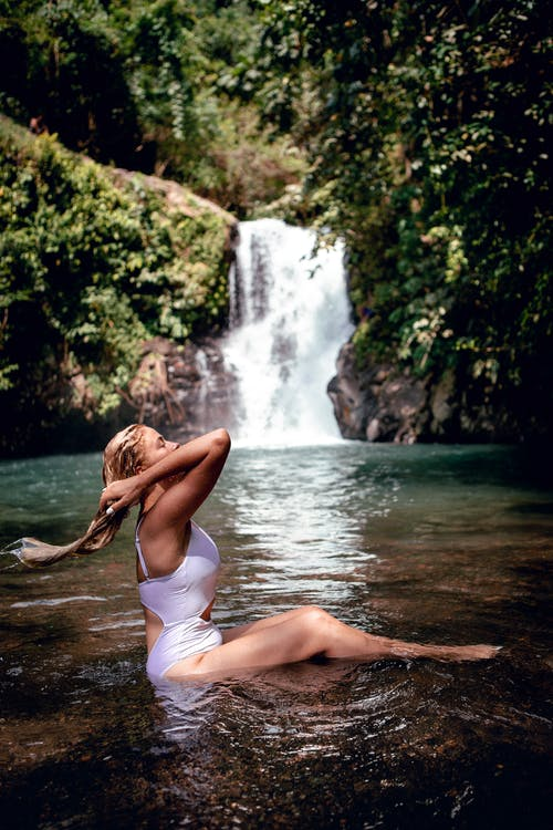 Photo of Woman Sitting on River