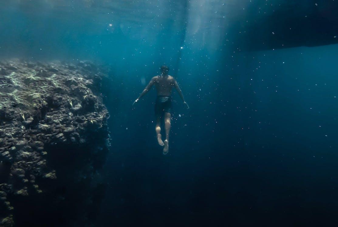Man Under Body Of Water