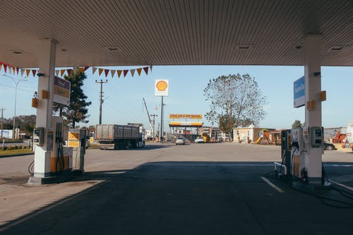 Empty gas station with oil petrol dispensers located on highway for serving long distance vehicles
