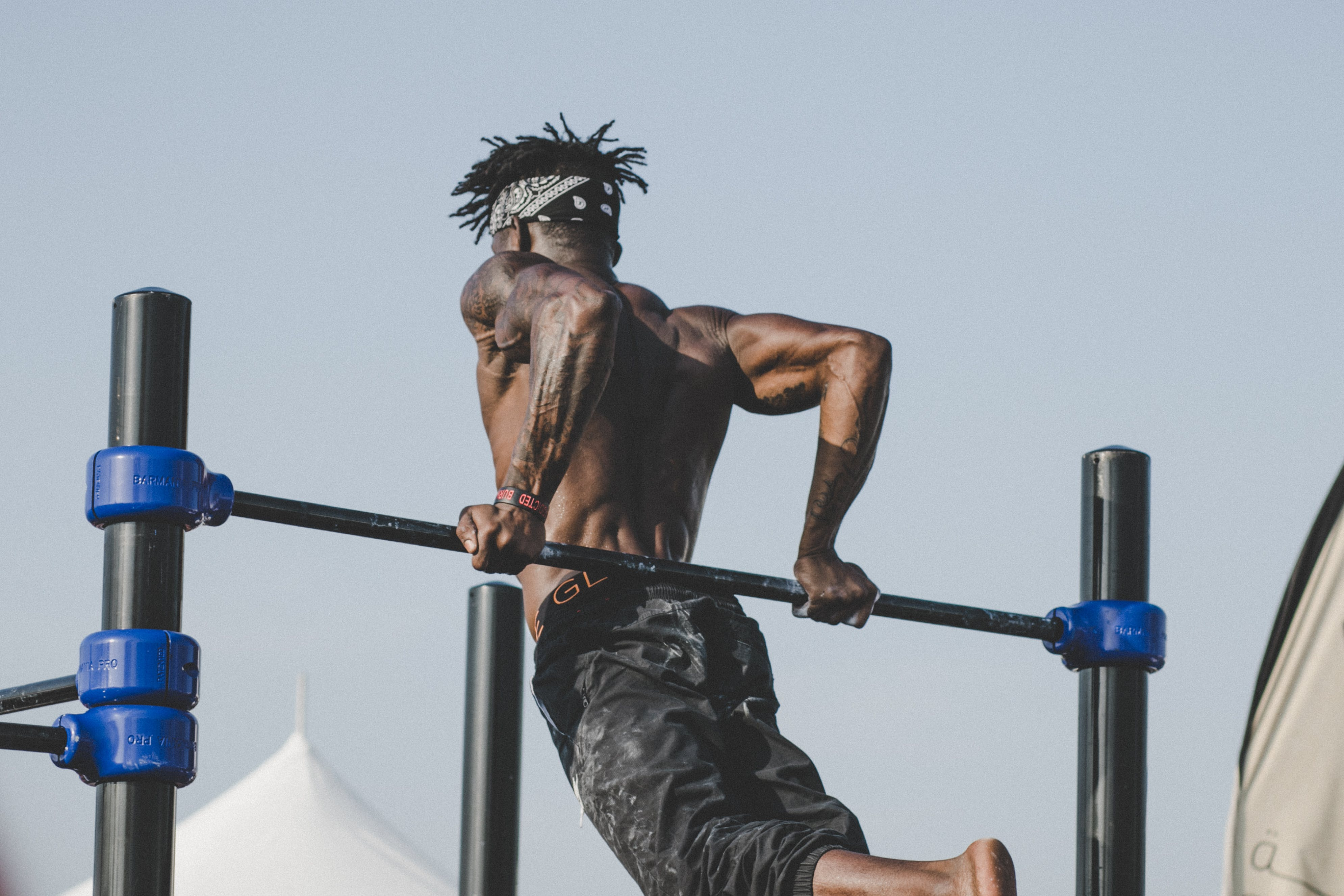 Man in Black Jeans Doing Pull-ups