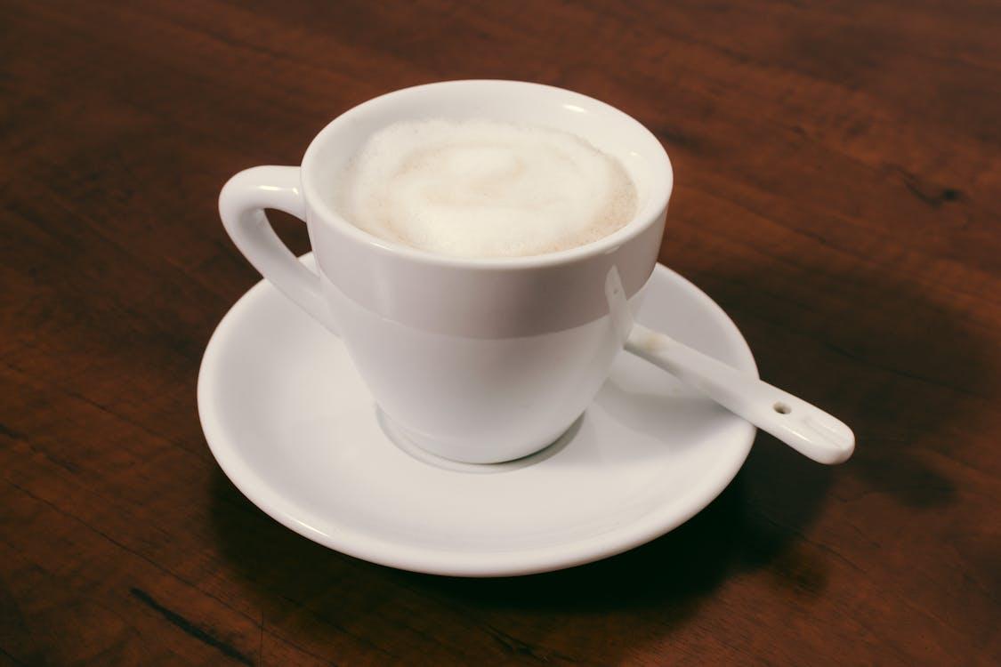 Filled Ceramic Mug on Saucer