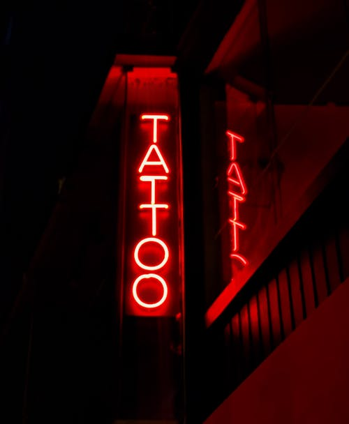 Red and White Tattoo Neon Light Signage