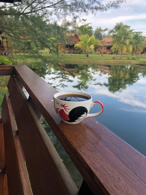Gratis stockfoto met gezette koffie, meer, veranda, vijver