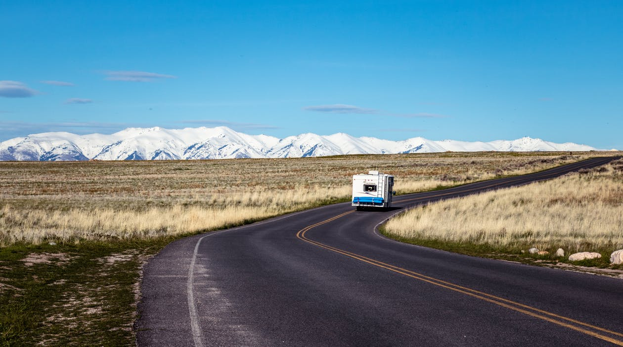 White Vehicle Traveling on Road