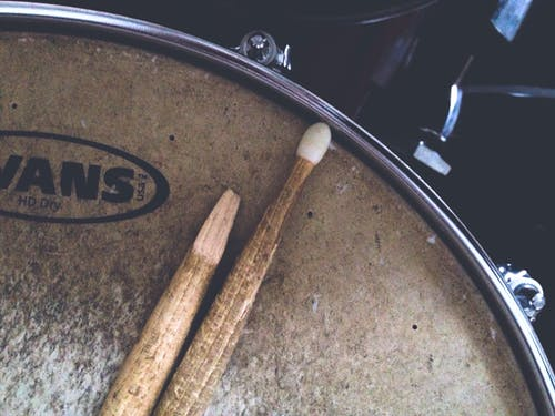 Two Brown Drum Sticks on Brown Snare Stick