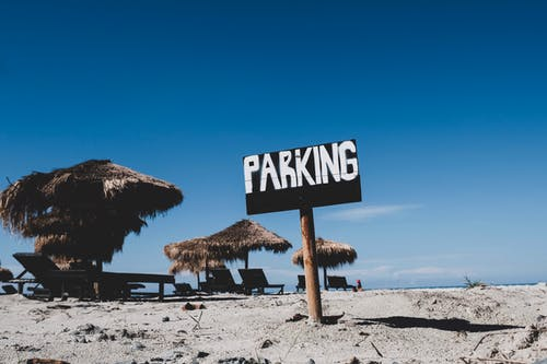 Photo of Parking Sign on Sand