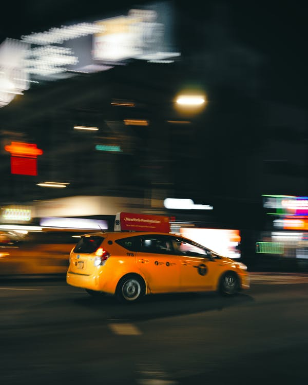 Photo Of Yellow Car On Road