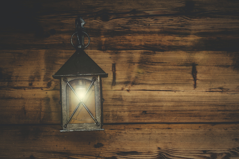Black Metal Candle Lantern Hanging on Wood Wall