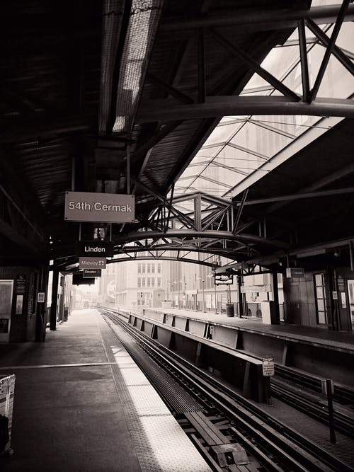 Grayscale Photo of Empty Train Station