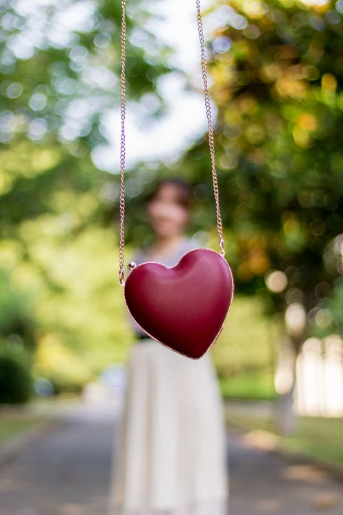 Selective Focus Photography of Heart Pendant Chain Link Necklace