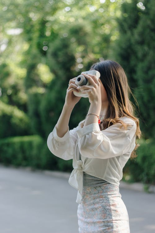 Woman Holding Instant Camera