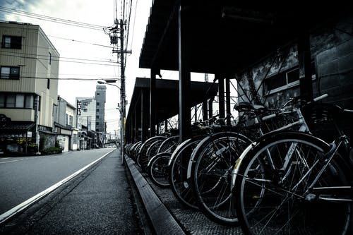Grayscale Photography of Bikes Park Outside