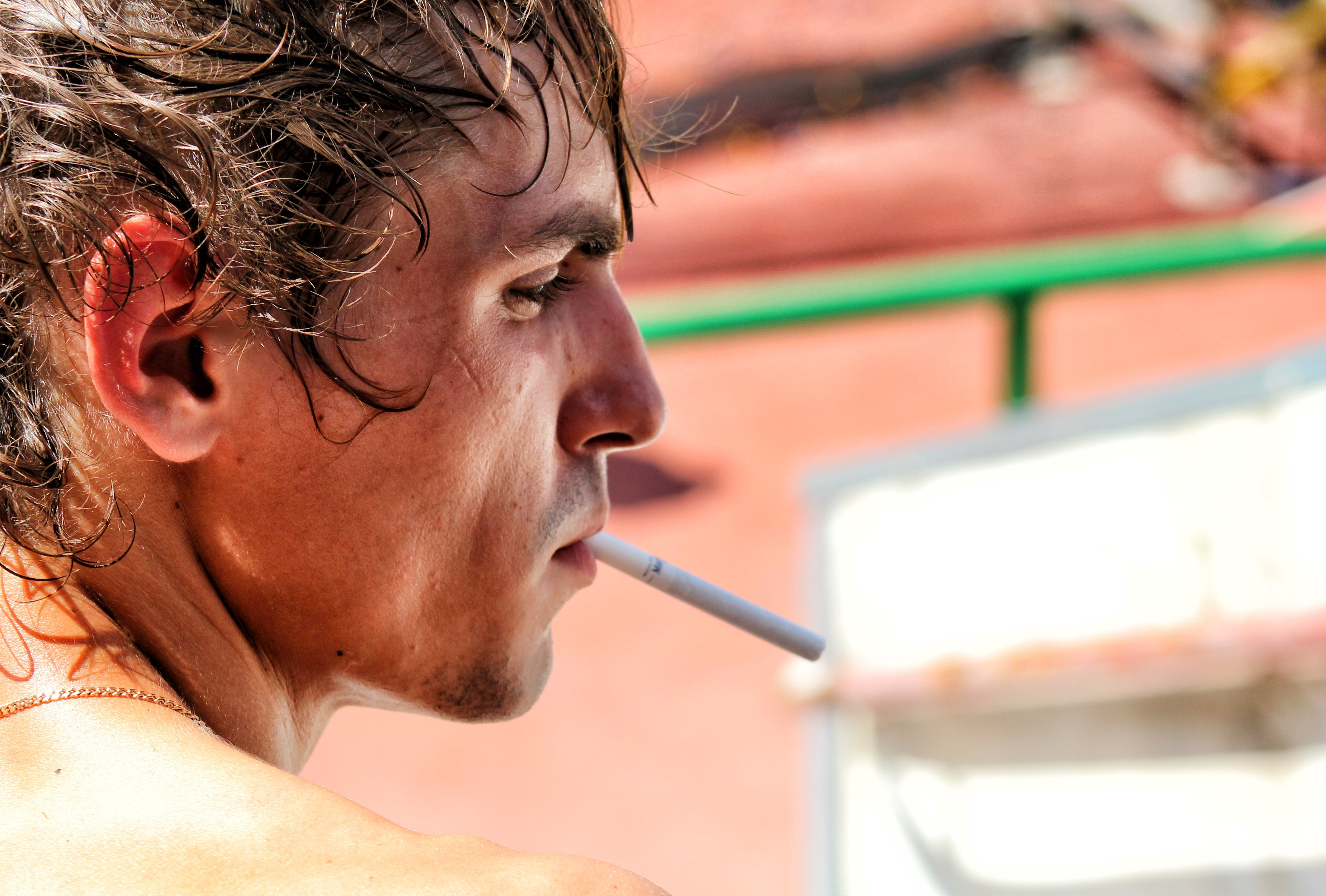 Free stock photo of man, person, cigarette, smoking