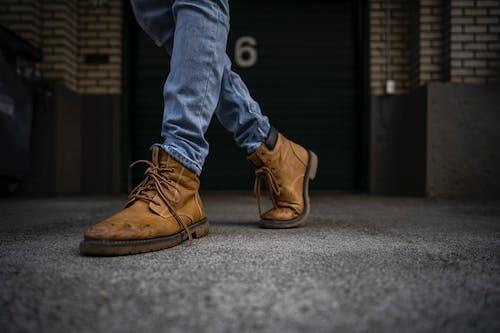 Foto profissional grátis de calçados, chuteiras, pés