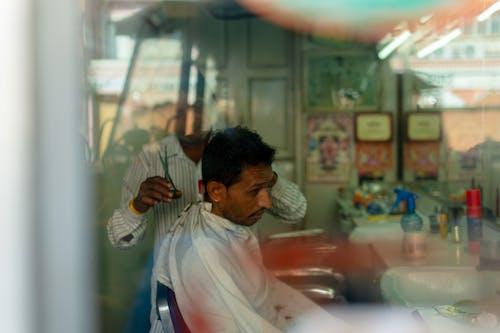 Man Inside Barber Shop