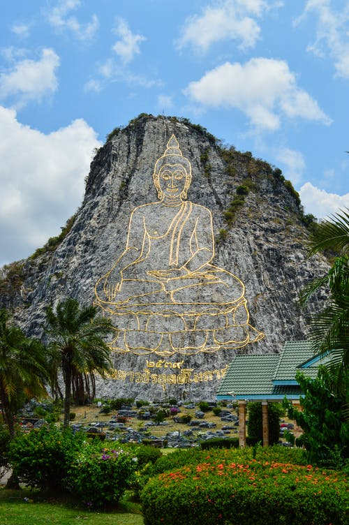 Rock Formation With Buddha Artwork