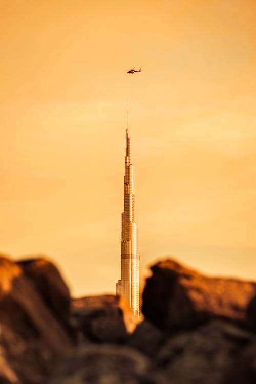 Photo of Helicopter Flying Over Burj Khalifa