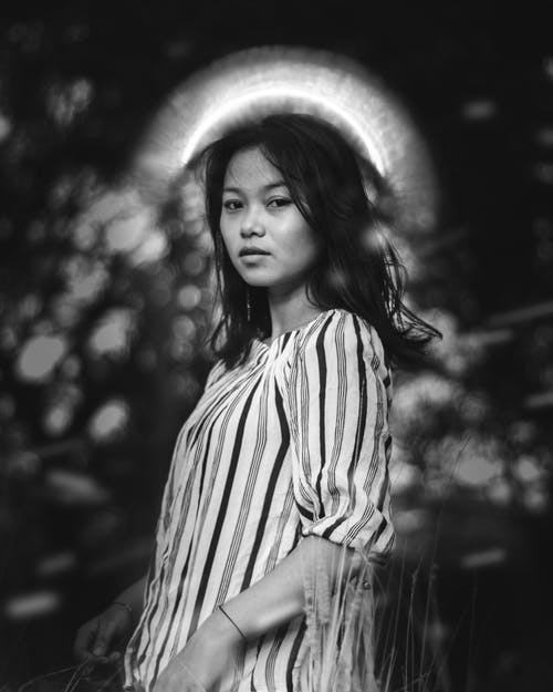 Grayscale Photo of Woman Wearing Stripe Top