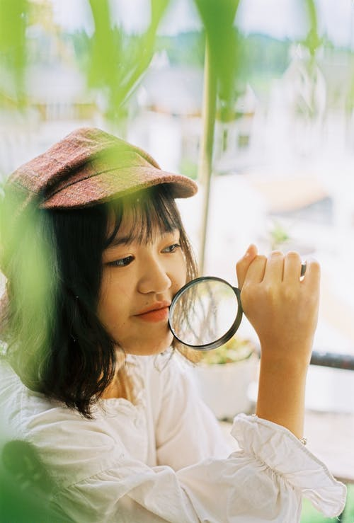 Photo of Girl Holding Magnifying Glass