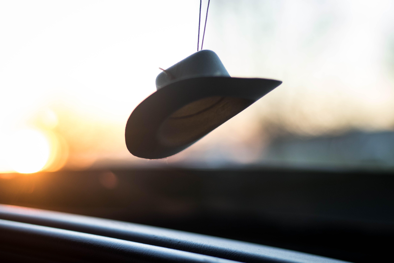 White Fedora Hat Hanged during Golden Hour