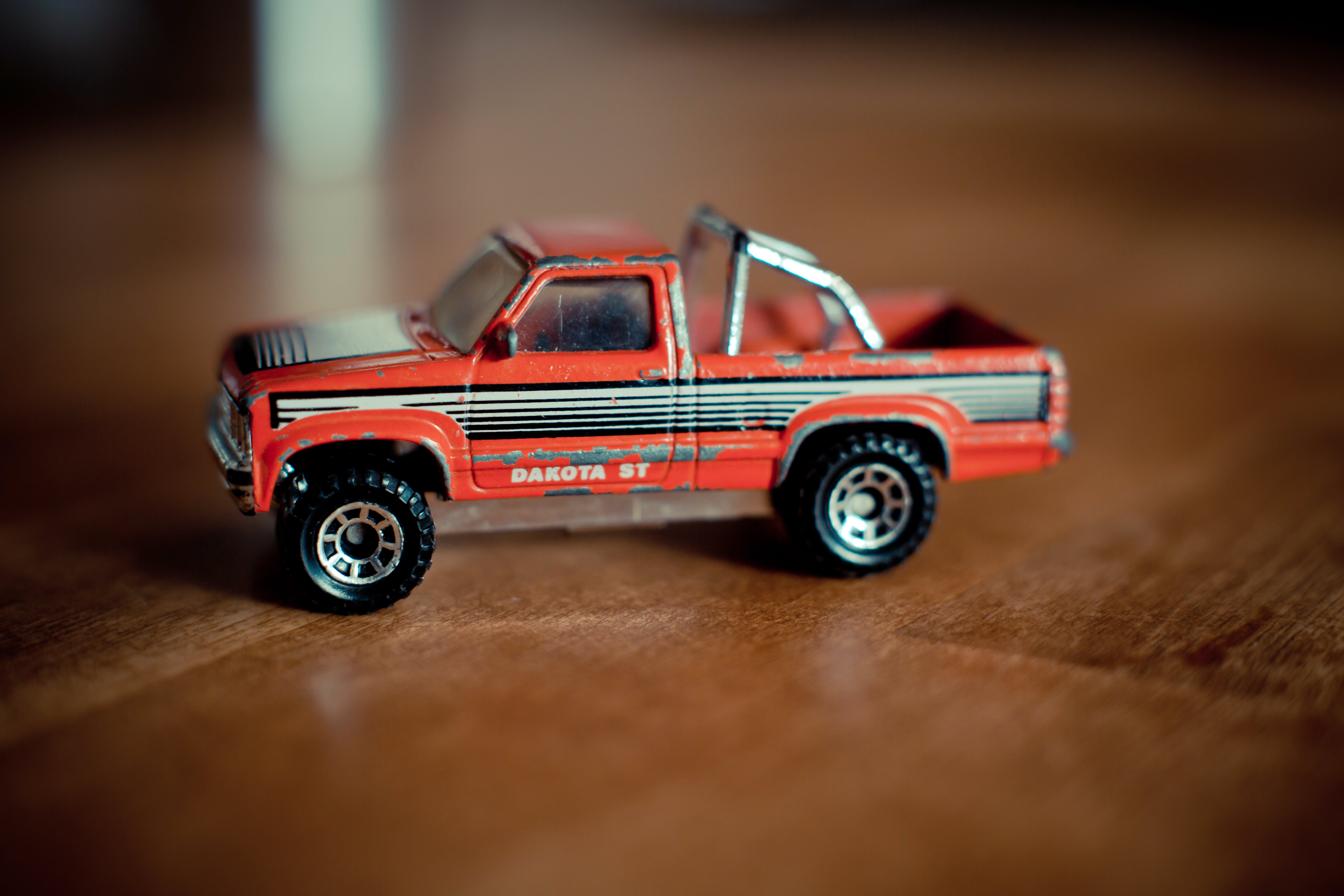 Red and Gray Single Cab Pickup Truck Scale Model on Table