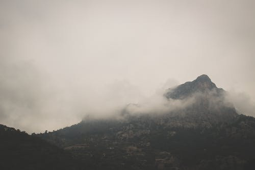 Cloud covered mountain top on foggy day