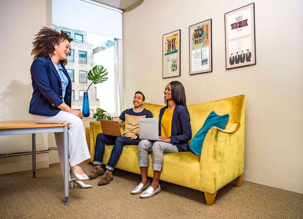 Three People Sitting Inside Room
