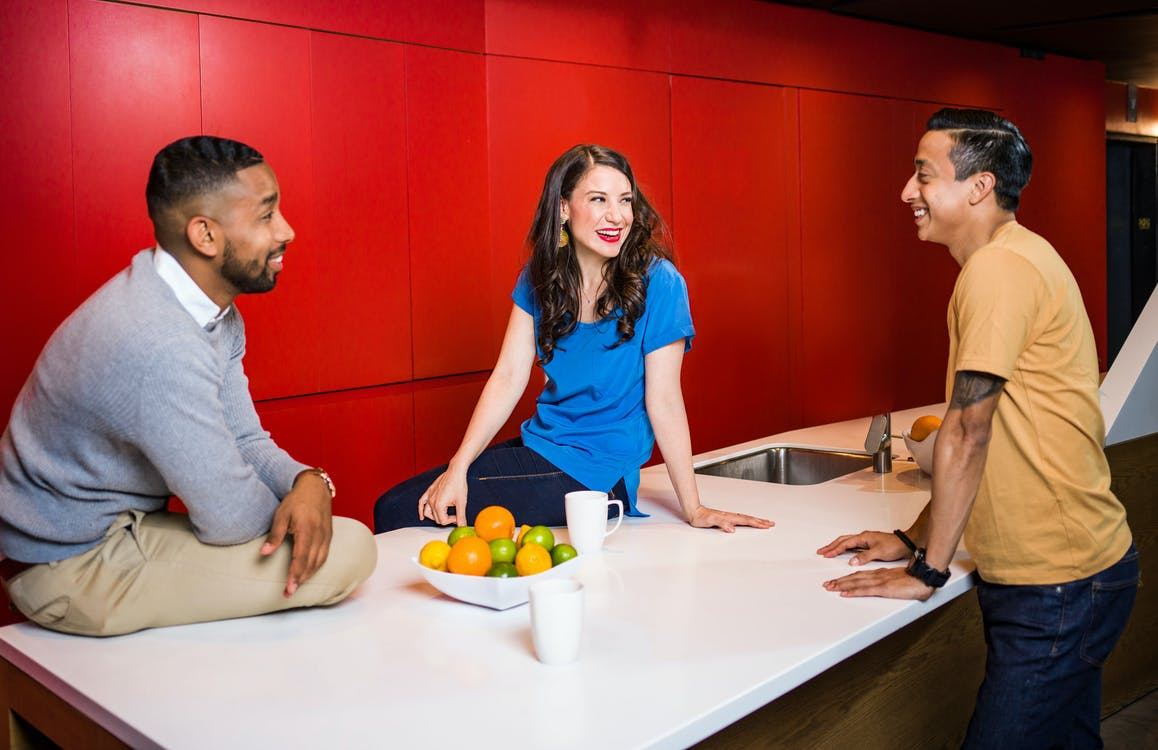 Three People Near Table Talking