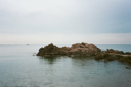 Photo of Rock Formation On Seashore