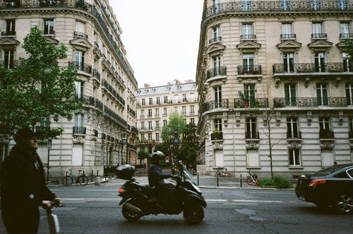 Photo of Person Riding Motorcycle