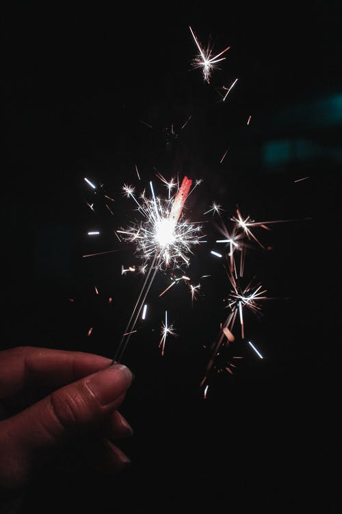 Person Holding Firecracker Photo