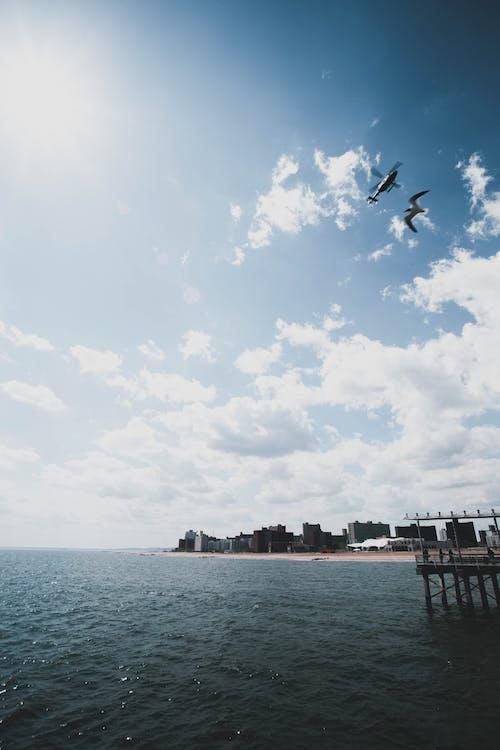 Photos gratuites de bord de mer, ciel, eau, espace extérieur