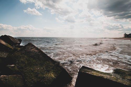 Photos gratuites de aube, bord de mer, caillou, cailloux