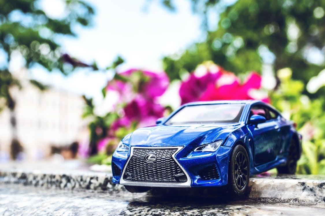 Blue Lexus Toy Car on the Street