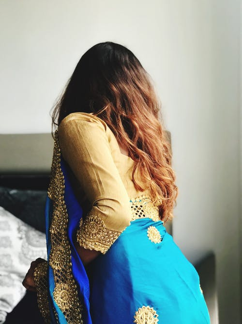 Women's wearing  a brown and blue traditional Indian dress