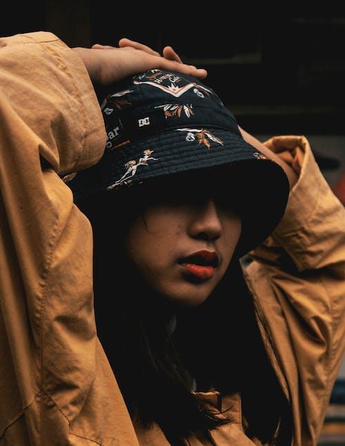 Free stock photo of cap, dark, moody, portrait