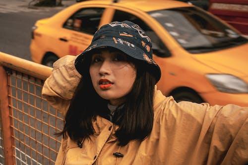 Free stock photo of cap, portrait, portrait photography, railing