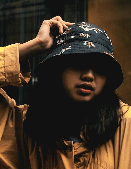Free stock photo of asian girl, cap, dark, portrait