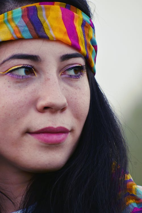 Close-up Photo of Woman Wearing Purple Eyeliner