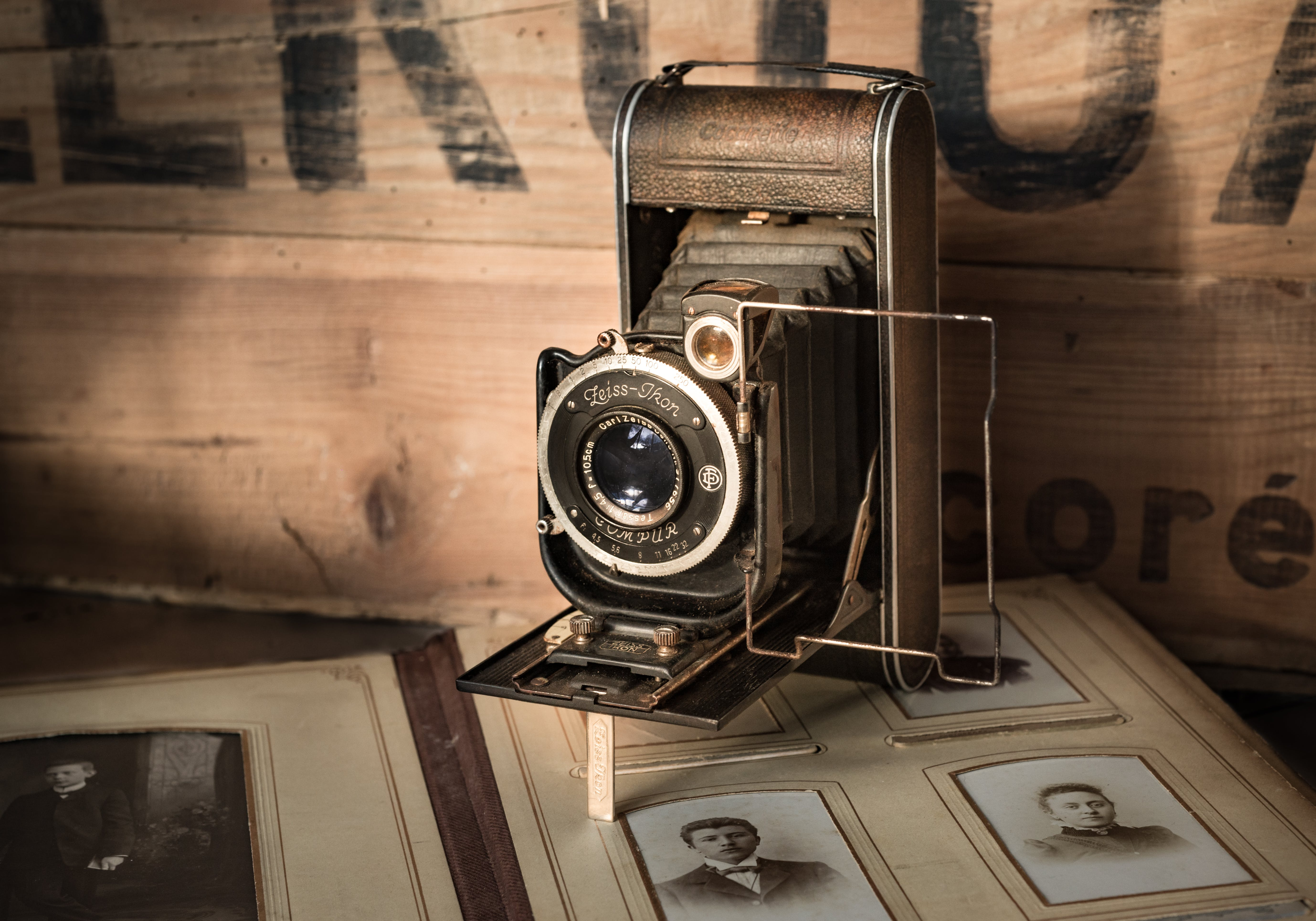 Vintage Black Camera on Brown Surface