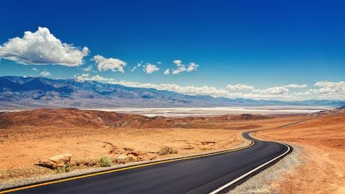 Landscape Photo of Road Under Blue Sky