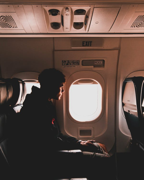 Silhouette Of Man Sitting Inside Airplane
