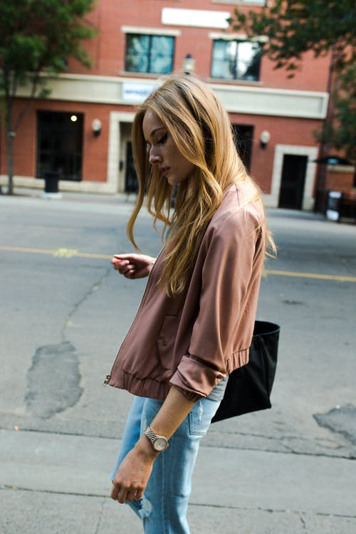 Photo of Woman Walking on Street