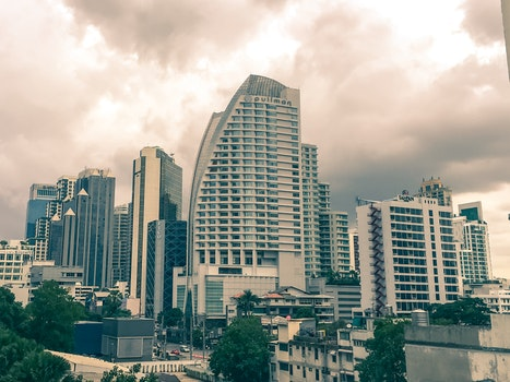 Free stock photo of city, clouds, street, skyline