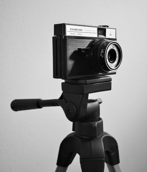 Greyscale Photo Of Camera On Tripod