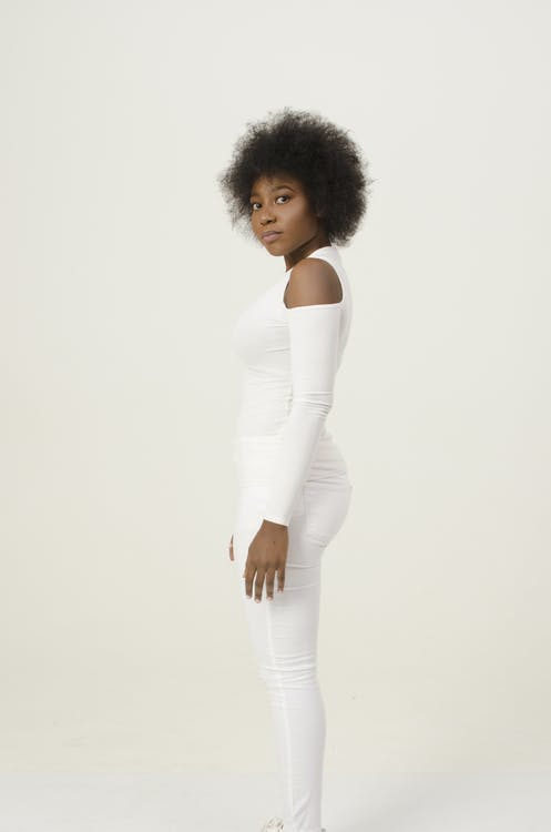 Woman in White Cold-shoulder Catsuit Standing