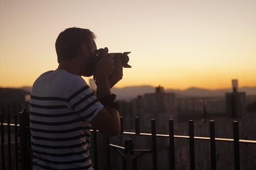 Man Taking a Photo Using a Dslr Camera