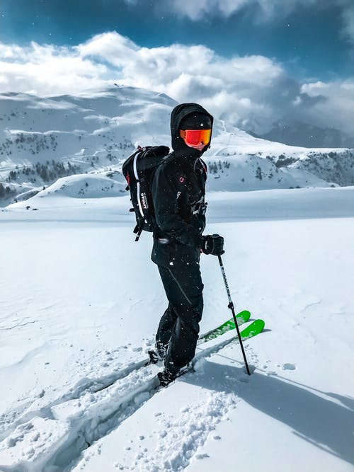 Man riding ski-boards